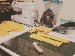 crafting desk with sewing machine and yellow fabric