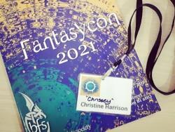 FantasyCon programme and badge